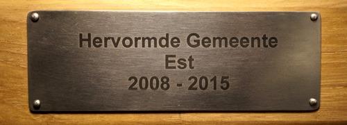 tekstplaatje op houten tuinbanken